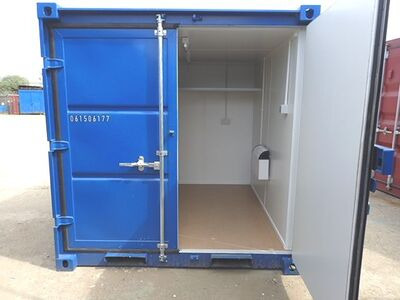 CONTAINER CONVERSION CASE STUDIES 8ft melamine lined, steel shelf and electrics CS29880